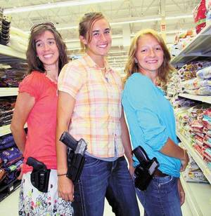 Photo - In this courtesy photo, (left to right) Qadoshyah Fish, vice chair of the Cherokee County Republican Party, Hannah Young and Suriyah Fish are licensed for open carry.