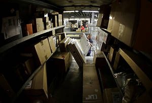 Photo - FILE - In this Monday, Dec. 16, 2013, file photo, driver Kyle Woodroof loads packages in his delivery truck in Kansas City, Mo. The Commerce Department reports on U.S. factory orders in December on Tuesday, Feb. 4, 2014. (AP Photo/Charlie Riedel, File)