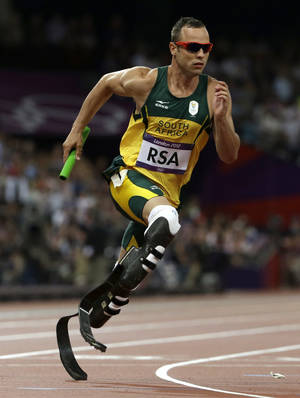 Photo -   South Africa's Oscar Pistorius runs in the final leg of the men's 4 x 400-meter relay final during the athletics in the Olympic Stadium at the 2012 Summer Olympics, London, Friday, Aug. 10, 2012. (AP Photo/Anja Niedringhaus)