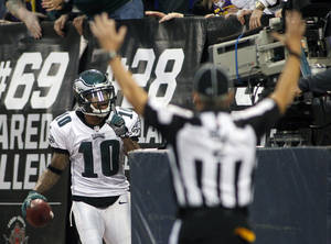 Photo - Philadelphia Eagles wide receiver DeSean Jackson reacts after catching a 30-yard touchdown pass during the second half of an NFL football game against the Minnesota Vikings, Sunday, Dec. 15, 2013, in Minneapolis. (AP Photo/Andy King)