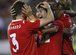 Photo - Sevilla's Coke celebrates on the end their Europa League semifinal second leg soccer match against Valencia at the Mestalla stadium in Valencia, Spain, Thursday, May 1, 2014. alencia lost 2-0 in the first leg at Sevilla. The game ended 3-1 and Sevilla qualified for the final Europa League. (AP Photo/Alberto Saiz)