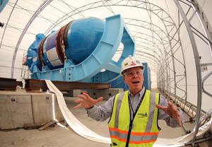 Photo - In this Friday, June 13, 2014 photo, Buzz Miller, executive vice president of nuclear development at Southern Co., stands in front of the high-pressure vessel that will be used in a new nuclear reactor at Plant Vogtle power plant in Waynesboro, Ga. Before it started building, the nuclear industry promised its new generation of plants would be constructed using giant Lego-like modules that make building faster, cheaper and produce a higher-quality result. Instead, the Louisiana factory building these modules has failed to master quality control rules, stick to schedule or replicate the approved designs, adding time and significant cost to first-of-their-kind projects. (AP Photo/John Bazemore)