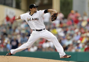 Photo - Miami Marlins starting pitcher Nate Eovaldi throws during the first inning of an exhibition spring training baseball game against the Boston Red Sox Thursday, March 6, 2014, in Jupiter, Fla. (AP Photo/Jeff Roberson)