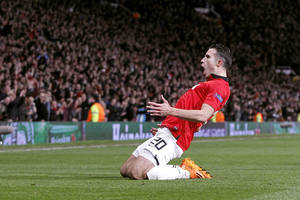 Photo - Manchester United's Robin van Persie celebrates scoring his side's third goal  and his hat-trick, during the Champions League, Round of 16, second leg match against Olympiakos,  at Old Trafford, Manchester,  England, Wednesday March 19, 2014. (AP Photo /PA, Peter Byrne) UNITED KINGDOM OUT