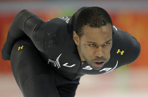 Photo - Speedskater Shani Davis of the U.S. trains at the Adler Arena Skating Center during the 2014 Winter Olympics in Sochi, Russia, Friday, Feb. 7, 2014. (AP Photo/Patrick Semansky)