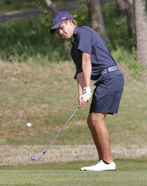 Photo - Edmond North's Nick Heinen chips a shot onto the green during Boy's 6A golf championships at the Karsten Creek Golf Course in Stillwater, OK, Tuesday, May 7, 2013,  By Paul Hellstern, The Oklahoman