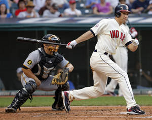 Photo - FILE - In this June 18, 2011, file photo, Cleveland Indians' Grady Sizemore watches his RBI-double in the second inning against the Pittsburgh Pirates in an interleague baseball game in Cleveland. Pirates catcher Michael McKenry is at left. Sizemore has agreed to a $750,000, one-year contract with the Boston Red Sox. A three-time All-Star, the 31-year-old has played eight major league seasons, all with Cleveland. He hit .269 with 139 homers and 458 RBIs. (AP Photo/Amy Sancetta, File)