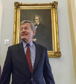 Photo - Senate Finance Committee Chairman Max Baucus, D-Mont., walks to a Democratic Caucus lunch at the Capitol in Washington, Thursday, Dec. 19, 2013. Baucus, who announced earlier this year that he would not seek re-election, is President Barack Obama's choice to be the next U.S. ambassador to China. (AP Photo/J. Scott Applewhite)