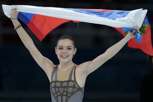 Photo - Adelina Sotnikova of Russia celebrates winning the women's free skate figure skating finals following the flower ceremony at the Iceberg Skating Palace during the 2014 Winter Olympics, Thursday, Feb. 20, 2014, in Sochi, Russia. (AP Photo/Ivan Sekretarev)