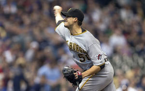 Photo - Pittsburgh Pirates' Charlie Morton pitches to a Milwaukee Brewers batter during the first inning of a baseball game on Sunday, April 13, 2014, in Milwaukee. (AP Photo/Tom Lynn)