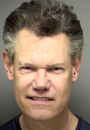 Photo -   This Feb. 6, 2012 booking photo provided by the Denton County Sheriff's Department in Texas, shows country music star Randy Travis. Travis was arrested in Sanger, Texas, on Monday, Feb. 6, 2012, on a charge of public intoxication. (AP Photo/Denton County Sheriff's Department)