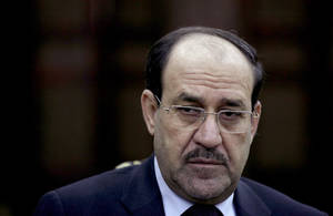 Photo - FILE - In this Wednesday, Feb. 27, 2013, file photo, Iraqi Prime Minister Nouri al-Maliki listens to a question during an interview with The Associated Press in Baghdad. On Tuesday, Aug. 12, 2014, al-Maliki ordered security forces not to intervene in the current political crisis over who will be the next prime minister, but rather focus on defending the country, which is under attack by Sunni militants in the north. (AP Photo/ Khalid Mohammed, File)
