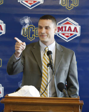 Photo - The University of Central Oklahoma announced that Nick Bobeck a former player and graduate assistant for the Bronchos has been named as the new head football coach during a press conference in Edmond , Wednesday  January , 04,  2012. Photo by Steve Gooch, The Oklahoman