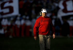 Photo - BEDLAM FOOTBALL: Oklahoma coach Bob Stoops walks the sidelines during the Bedlam college football game between the University of Oklahoma Sooners (OU) and the Oklahoma State University Cowboys (OSU) at Gaylord Family-Oklahoma Memorial Stadium in Norman, Okla., Saturday, Nov. 24, 2012. Oklahoma won 51-48. Photo by Bryan Terry, The Oklahoman