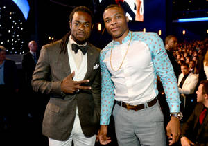 Photo - Richard Sherman, left, and Russell Westbrook pose in the audience at the ESPY Awards at the Nokia Theatre on Wednesday, July 16, 2014, in Los Angeles. (Photo by Jordan Strauss/Invision/AP)