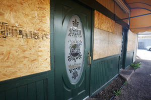 Photo - The windows of a Coit's Root Beer Stand are boarded up on Western Avenue at SW 24 Street in Oklahoma City.