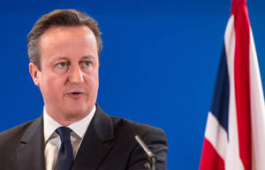 Photo - FILE - In this March 21, 2014, file photo, British Prime Minister David Cameron addresses members of the media at the end of an EU summit in Brussels. Cameron pledged Thursday, July 10, 2014, to rush through fresh measures to give police and spy agencies the power to scoop up mobile phone and Internet data. (AP Photo/Geert Vanden Wijngaert, File)