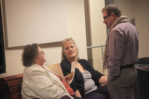 photo - Susan Goldsberry, center, visits with Pioneer Library System Assistant Director Theresa Dickson and former branch manager Chris Kennedy. PHOTOS PROVIDED