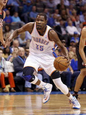 photo - Kevin Durant drives to the basket as the Oklahoma City Thunder play the Portland Trail Blazers in NBA basketball at the Chesapeake Energy Arena in Oklahoma City, on Friday, Nov. 2, 2012.  Photo by Steve Sisney, The Oklahoman