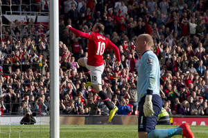 Photo - Manchester United's Wayne Rooney, centre, celebrates after scoring a penalty past Norwich City's goalkeeper John Ruddy, right, during their English Premier League soccer match at Old Trafford Stadium, Manchester, England, Saturday April 26, 2014. (AP Photo/Jon Super)
