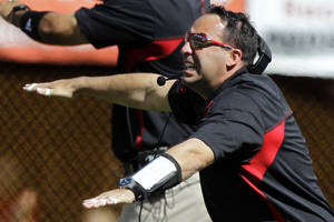 photo -   Nebraska defensive coordinator John Papuchis signals his players in the first half of an NCAA college football game against Arkansas State in Lincoln, Neb., Saturday, Sept. 15, 2012. Papuchis took over coaching the game after head coach Bo Pelini was taken to hospital at halftime. (AP Photo/Nati Harnik)
