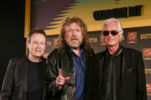 Photo -   Bassist and keyboardist John Paul Jones, from left, frontman Robert Plant and guitarist Jimmy Page appear at a media screening ahead of the worldwide theatrical release of Led Zeppelin's 2007 Celebration Day concert at the O2, on Friday, Sept. 21, 2012 in London. (Photo by Miles Willis/Invision/AP)