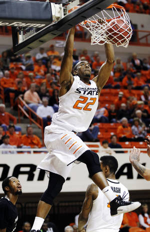 Photo -   Oklahoma State guard Markel Brown dunks against Portland State in the first half of an NCAA college basketball game in Stillwater, Okla., Sunday, Nov. 25, 2012. Oklahoma State won 81-58. (AP Photo/Sue Ogrocki)