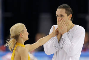 Photo - Tatiana Volosozhar and Maxim Trankov of Russia react after they competed in the pairs free skate figure skating competition at the Iceberg Skating Palace during the 2014 Winter Olympics, Wednesday, Feb. 12, 2014, in Sochi, Russia. (AP Photo/Vadim Ghirda)