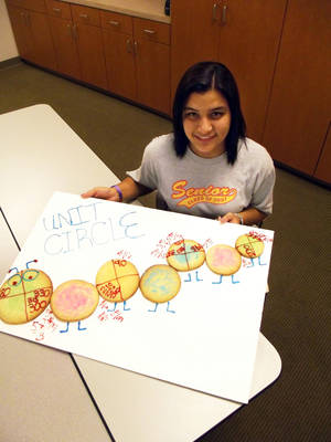 photo - Mustang senior Sierra Bailey placed trig unit circles on sugar cookies that make up a caterpillar.  Photo provided by Canadian Valley Technology Center