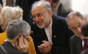 photo - Iranian Foreign Minister Ali Akbar Salehi, center, arrives for the Security Conference in Munich, Germany, on Sunday, Feb. 3, 2013. The 49th Munich Security Conference started Friday afternoon until Sunday attended by experts from 90 delegations. (AP Photo/Matthias Schrader)