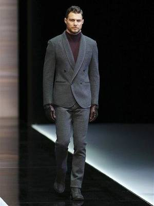 Photo - A model wears a creation for Giorgio Armani men's Fall-Winter 2013-14 collection, part of the Milan Fashion Week, unveiled in Milan, Italy, Tuesday, Jan. 15, 2013. (AP Photo/Antonio Calanni)