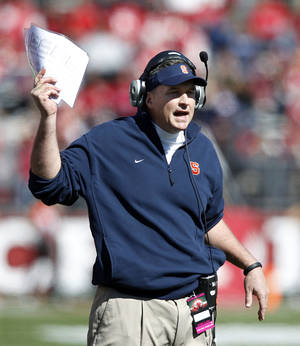 photo -   Syracuse head coach Doug Marrone shouts to his players during the first half of an NCAA college football game against Rutgers at High Points Solutions stadium in Piscataway, N.J., Saturday, Oct. 13, 2012. Rutgers won 23- 15. (AP Photo/Mel Evans)