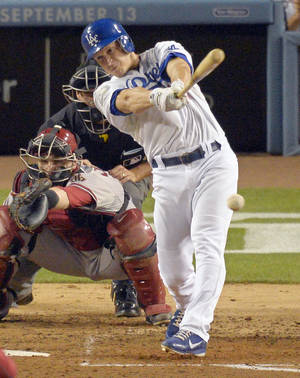 Photo -   Los Angeles Dodgers' Mark Ellis, right, hits a two RBI single as Arizona Diamondbacks catcher Miguel Montero catches during the fifth inning of their baseball game, Friday, Aug. 31, 2012, in Los Angeles. (AP Photo/Mark J. Terrill)