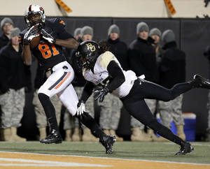 Photo - Oklahoma State's Jhajuan Seales (81) catches a touchdown pass as Baylor's Joe Williams (22) defends in the fourth quarter during a college football game between the Oklahoma State University Cowboys (OSU) and the Baylor University Bears (BU) at Boone Pickens Stadium in Stillwater, Okla., Saturday, Nov. 23, 2013. Photo by Sarah Phipps, The Oklahoman