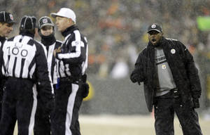 Photo - Pittsburgh Steelers head coach Mike Tomlin argues a call during the second half of an NFL football game against the Green Bay Packers Sunday, Dec. 22, 2013, in Green Bay, Wis. (AP Photo/Jeffrey Phelps)