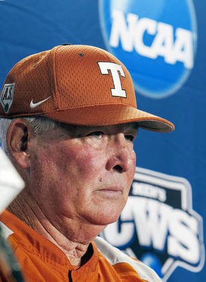 Photo - FILE- In this June 17, 2011, file photo, Texas coach Augie Garrido takes a question during an NCAA college baseball news conference at TD Ameritrade Park in Omaha, Neb. ahead of the NCAA College World Series. The Longhorns (20-15, 4-8) are tied for last in the Big 12 going into this weekend's home series against West Virginia. They've lost seven straight conference series dating back to last season. (AP Photo/Nati Harnik, File)