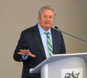 Photo - North Dakota Gov. Jack Dalrymple addresses representatives from about two dozen states at the Energy-Producing States Summit in Bismarck, N.D, Wednesday, April 16, 2014. The two-day summit began Wednesday and was hosted by the state Health Department and Bismarck-based Basin Electric Power Cooperative. (AP Photo/The Bismarck Tribune, Tom Stromme)