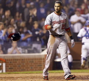 Photo - Washington Nationals' Ian Desmond throws his helmet after striking out during the sixth inning of a baseball game against the Chicago Cubs in Chicago, Thursday, June 26, 2014. (AP Photo/Nam Y. Huh)
