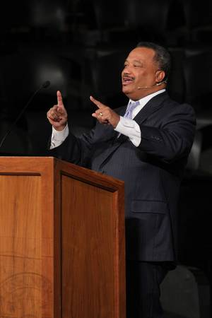 Photo - The Rev. Fred Luter, president of the Southern Baptist Convention and senior pastor of Franklin Avenue Baptist Church in New Orleans, La., delivers a sermon Monday at Oklahoma Baptist University in Shawnee. OBU Photo by Bill Pope      <strong></strong>