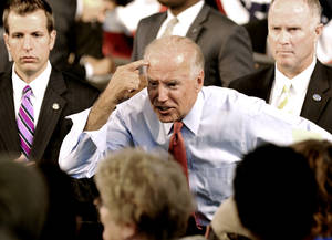 Photo -   Vice President Joe Biden points to his head as he greets supporters after he addressed a grassroots rally, Tuesday, Aug. 21, 2012, in Minneapolis. (AP Photo/Jim Mone)