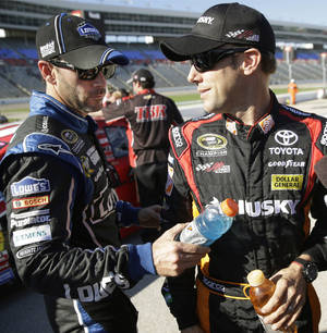 Photo - Jimmie Johnson, left, playfully interrupts Matt Kenseth as Kenseth gives an interview during qualifying for Sunday's NASCAR Sprint Cup series auto race at Texas Motor Speedway in Fort Worth, Texas, Friday, Nov. 1, 2013. (AP Photo/LM Otero)
