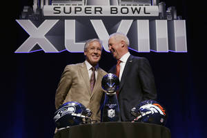 Photo - Seattle Seahawks head coach Pete Carroll, left, and Denver Broncos head coach John Fox laugh as they pose behind the Vince Lombardi Trophy before speaking at a news conference Friday, Jan. 31, 2014, in New York. The Seahawks and the Broncos are scheduled to play in the NFL Super Bowl XLVIII football game on Sunday, Feb. 2, at MetLife Stadium in East Rutherford, N.J. (AP Photo/Matt Slocum)