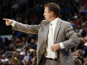 Photo - Oklahoma City head coach Scott Brooks gives instructions to his team during the NBA basketball game between the Minnesota Timberwolves and the Oklahoma City Thunder at the Oklahoma City Arena, Monday, November 22, 2010, in Oklahoma City. Photo by Nate Billings, The Oklahoman