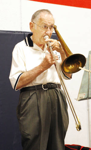 "Photo - Clyde ""The Slide"" Miller plays the trombone during the Salvation Army Senior Living Fair. The fair was held as part of National Salvation Army Week. Photo by Paul B. Southerland, The Oklahoman <strong>PAUL B. SOUTHERLAND - PAUL B. SOUTHERLAND</strong>"