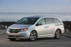 Photo - This undated photo provided by Honda shows the 2014 Honda Odyssey. (AP Photo/Honda)