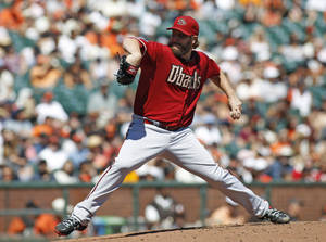 Photo - Arizona Diamondbacks pitcher Wade Miley throws to the San Francisco Giants during the first inning of a baseball game, Sunday, Sept. 8, 2013, in San Francisco. (AP Photo/George Nikitin)