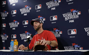 Photo - St. Louis Cardinals starting pitcher Adam Wainwright answers a question during a news conference Tuesday, Oct. 22, 2013, in Boston. Wainwright is scheduled to start against the Boston Reds Sox in Game 1 of baseball's World Series on Wednesday.   (AP Photo/David J. Phillip)