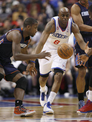 Photo - Charlotte Bobcats' Michael Kidd-Gilchris, left and Philadelphia 76ers' Damien Wilkins (8) chase the loose ball in the first half of an NBA basketball game, Saturday, March 30, 2013, in Philadelphia. (AP Photo/H. Rumph Jr)