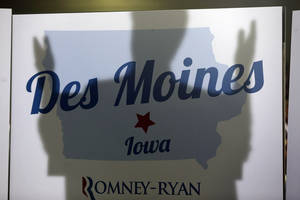 Photo -   The shadow of Republican presidential candidate and former Massachusetts Gov. Mitt Romney is cast on a Des Moines sign as he campaigns at Iowa Events Center, in Des Moines, Iowa, Sunday, Nov. 4, 2012. (AP Photo/Charles Dharapak)