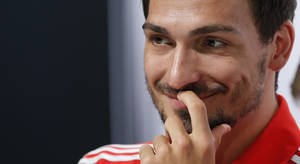 Photo - German national soccer player Mats Hummels smiles during a news conference in Santo Andre near Porto Seguro, Brazil, Monday, June 23, 2014. Germany play in group G of the 2014 soccer World Cup. (AP Photo/Matthias Schrader)